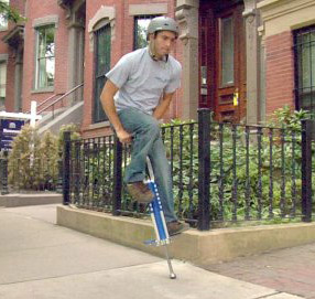 a guy jumping on the Master stick on a pavement