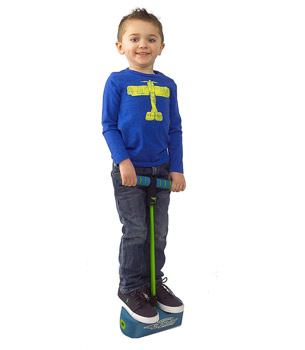 a boy standing on the pogo jumper